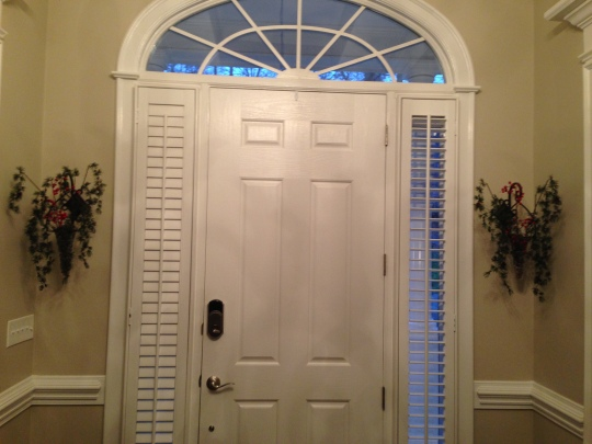 Glass vases on either side of the front door change out decorations seasonally often using fresh flowers.