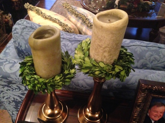 Small boxwood wreaths used as candle wreaths.