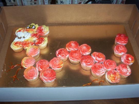 Homemade by me 2005-Chinese Dragon Cupcake cake using aerosol Betty Crocker icing