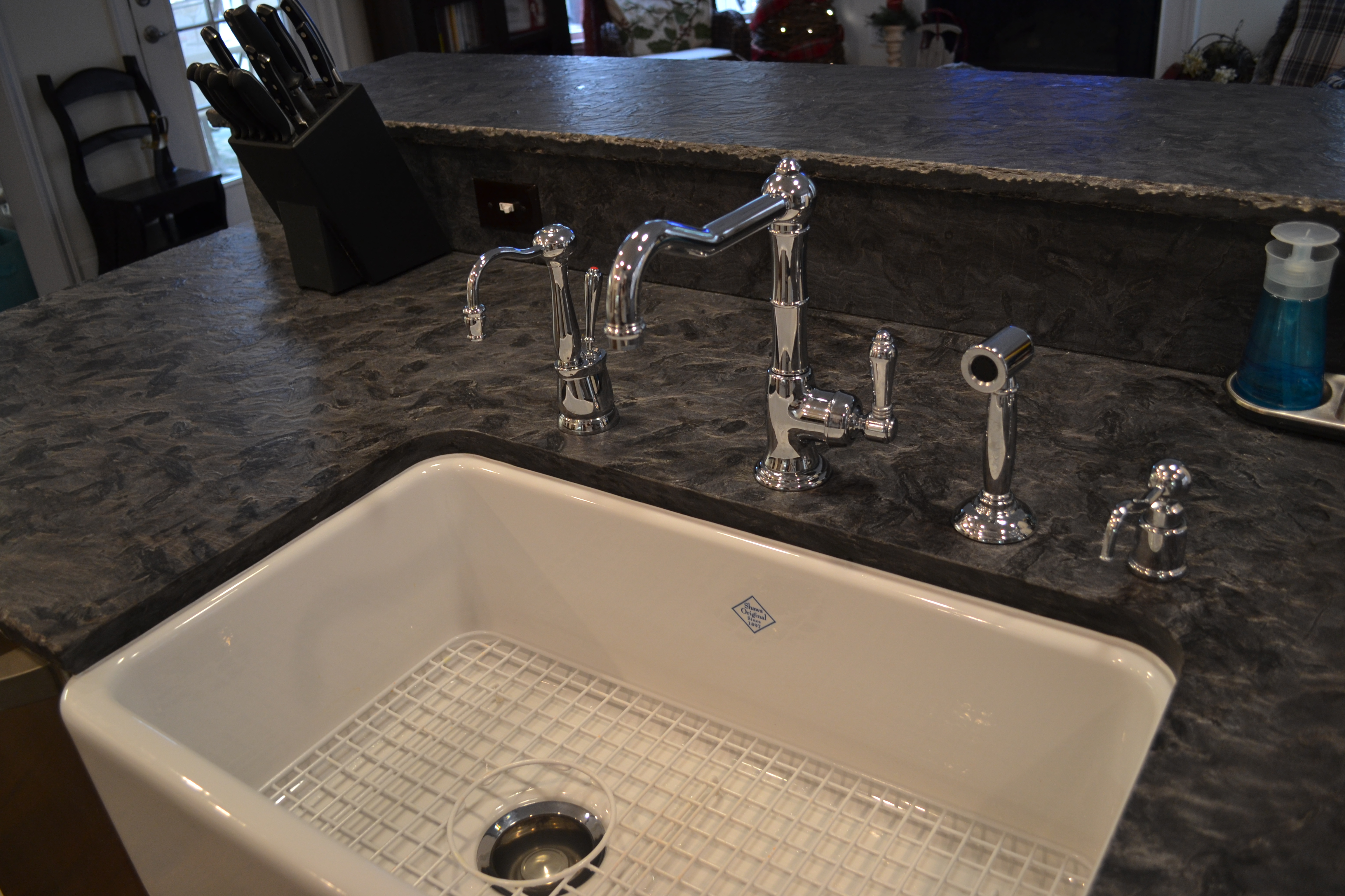Shaw Farmhouse Sink With Rohl Faucet.